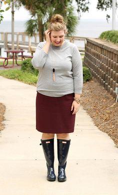 Navy gloss Hunter boots, garnet pencil skirt, grey sweater, rose gold/navy Kendra Scott tassel necklace, rose gold accessories