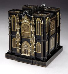 The Hausburg Cabinet - A Lost Masterpiece Rediscovered  The exterior a representation , as Hausburg states in his will, of the exterior of the Cathedral of Rheims, with the tracery, minute figures, Rose windows, doors and imbricated roof in brass and silver wire, and mother-of-pearl. The doors minutely depicting scenes from the interiors of King's College Chapel, Cambridge, and Wesminster Abbey.