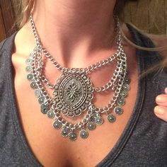 Super cute and stylish statement necklace! Silver statement necklace with super detailed beading and charms!!! Has a flower in the middle...goes with everything!!! Jewelry Necklaces