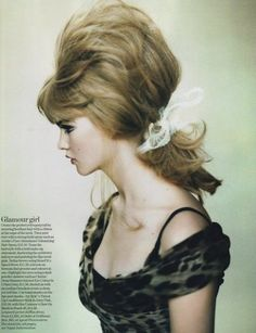 60's...ya gotta love the hairdo's of that era...remember them fondly..