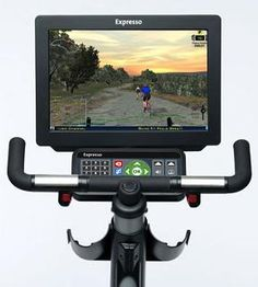 video game stationary bike lets you race against other people in the gym