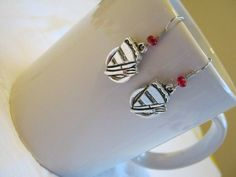 Items similar to Twin Peaks earrings. Five designs -- Fish in Percolator, Log Lady, Blue Rose Case, Damn Fine Coffee, RR Diner Pie. on Etsy David Lynch Twin Peaks, Retro Diner, Red Glass, Cherries, Antique Silver, Class Ring, Glass Beads, Bakery, Great Gifts