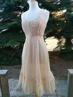 Check out this item in my Etsy shop https://www.etsy.com/listing/273810268/vintage-1970s-light-peach-summer-dress