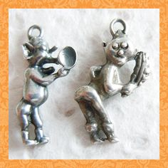 """Vintage 1930's Naughty Pixies Sterling Charms ~ From the old joke about the deaf man who meets a lady. The lady says, """"Particu'ly nasty weather"""" but the deaf man hears, """"Tickle me arse with yer feather."""""""