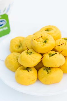 Easy recipe for kesar pedas, a festival sweet made with milk solids, saffron (kesar) and cardamom powder.