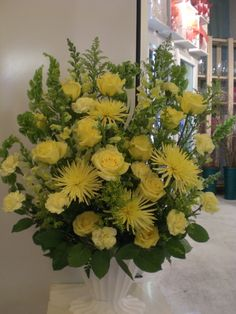 http://www.unny.com beautiful yellow funeral flowers arrangement