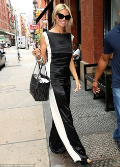 Marvelous in monochrome: Heidi Klum gave the black and white trend some class in this satiny jumpsuit which she wore to her appearance on Live With Kelly & Michael on Tuesday