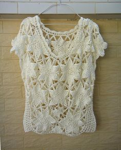 Elegant Exclusive Crochet Women Blouse Short Sleeve Perfect for creat a boho chic look, pair with skirt, short or jeans Measurement: Bust: M (36-38) Length: 23 Crocheted in easy care acrylic yarn, hand wash or roll in a towel to remove excess water and lay flat to dry. Your item