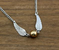Harry Potter Golden Snitch Necklace by AngelCities