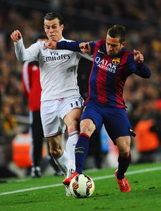 Gareth Bale of Real Madrid CF battles with Jordi Alba of Barcelona during the La Liga match between FC Barcelona and Real Madrid CF at Camp Nou on March 22, 2015 in Barcelona, Catalonia.
