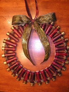 Shotgun shell wreath if I made this Nate might let me decorate for Christmas ; Holiday Crafts, Holiday Fun, Christmas Time, Christmas Wreaths, Christmas Bulbs, Christmas Decorations, Holiday Decor, Redneck Christmas, Xmas