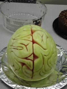 Here is a watermelon I carved as a brain. I first used a vegetable peeler to get rid of the dark green skin. I then used a small knife to score my brain pattern then began cutting.