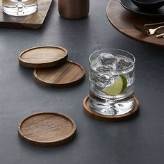Richly figured rounds of acacia wood feature raised rims to keep condensation contained and protect furniture surfaces. Four natural wood coasters are sanded, finished with a food safe oil and tied with twine for easy gifting.