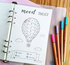 Keep track of how you feel in a mood tracker for your bullet journal. There are lots of great tracker ideas including this hot air balloon!