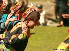 """Kalash girls-happiest people-Pakistan~Festivals are a significant part of Kalasha life, where girls gather in groups to clasp each other to dance, stomp and shuffle. Loveless liaisons hold no appeal for the spirited Kalasha women: """"We choose our husbands, and if they don't treat us well, or it doesn't work out, we can leave and find a new partner."""" Cited from: http://travel.cnn.com/mumbai/life/kalasha-happiest-people-pakistan-261067"""