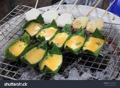 stock-photo-baked-egg-in-cup-made-of-banana-leaf-for-sale-in-local-market-thai-native-food-in-the-north-in-153995546.jpg 1,500×1,100 pixels