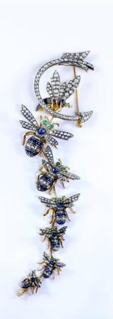 BEE AND CRESCENT ARROW BROOCH. Silver-upon-gold, bee and crescent arrow brooch, set with 8.50ct of rose-cut diamonds, 6.64ct of sapphires and cabochon-cut emerald eyes.