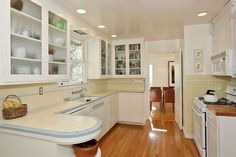 Creamy colored 1940s kitchen with blue trim