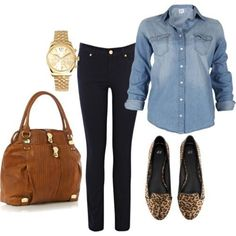 A long flight! Black jeans, blue jean shirt, flats, watch and large bag.