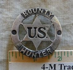 BOUNTY HUNTER  BADGE  (BADGES OF THE  OLD WEST)