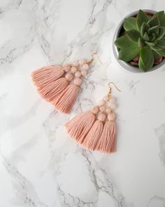 These blush pink tassel earrings with rose quartz beads are the perfect gift for a woman. These statement tassel earrings are fun summer boho style earrings. Tassel earrings are still trending, so get them as a gift for your sister, friend or yourself. These earrings will make your outfits more special.