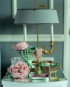 Shabby chic look: paper or crepe-paper flowers attached to or strewn around a room.  Would look great glued to a cheap white headboard--or, for a more modern, streamlined (but a bit feminine) look, paint the headboard black and make the flowers out of a high contrast color like white, red, turquoise, etc!  They'd also look great on a lampshade.  For entertaining, these roses would be great as napkin rings or in different colors tied around the stems of wine glasses so guests know which is…