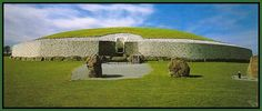 """Newgrange, in Ireland, is one of the Mysteries of The Ancient World.   It's one of several  burial mounds older than either the Pyramids or Stonehenge.  Every Dec. 21st , light penetrates thru the  """"roof-box"""" opening  ( the black square seen in the center of the photo ), and illuminates the entire length of a very long passage inside the tomb."""