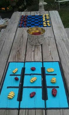 We have a small yard so utilizing space and making the most of what we have is the goal. Painted checker board and tic tac toe on picnic table. Painted rocks like lady bugs and bumblebees for pieces. Now 2 more games for kids to play outside. Painted Picnic Tables, Kids Picnic Table, Picnic Table Paint, Painted Game Table, Picnic Area, Backyard Games, Outdoor Games, Outdoor Decor, Outdoor Camping