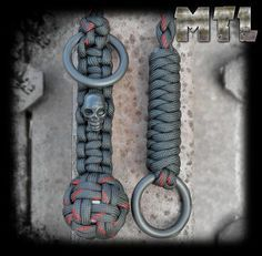 Black w/ thin red line Paracord Self Defense Lanyard (monkey fist) featuring steel ball and metal skull bead w/ welded rings - http://www.diyhomeproject.net/black-w-thin-red-line-paracord-self-defense-lanyard-monkey-fist-featuring-steel-ball-and-metal-skull-bead-w-welded-rings