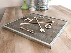 Reclaimed Wood Arrow Sign | Laser cut lettering and metal frame | CraftCuts.com