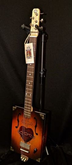 """The Clydesdale model: Beautiful vintage tobacco nitro-cellulose sunburst finish with double mini humbucker pick-ups. Florentine (F-hole) violin cut-outs. Daddy Mojo """"DM"""" Star logo silkscreened on back. The Clydesdale model features a maple neck, rosewood fingerboard and bridge, bone nut and sadd..."""