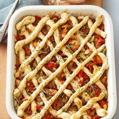 We flipped pizza on its head to give you more of what you love -- the toppings! Zucchini, sweet peppers, and chicken sausage smothered in marinara and mozzarella fill up this fun casserole. Crispy rolls of seasoned crust create a gorgeous and easy lattice topping./