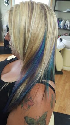 Chunky blonde highlights with blue, turquoise and purple through it ~ by Jenn's hair Studio
