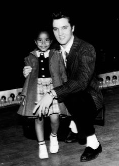 """""""Elvis Presley entertain Vaneese Thomas, then 3, (daughter of Rufus Thomas), who called him her """"boyfriend"""" on stage at Ellis Auditorium, Memphis, Tennessee, December 7, 1956. Photo by..."""