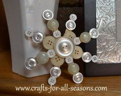 Snowflake button and craft stick craft