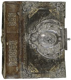 Silver adorned leather book