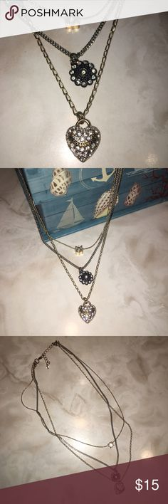 Juicy Couture Necklace Adorable three chain necklace! Worn once- great condition.    ⚓️ Only looking to sell my items  ⚓️ I do not trade, so please don't ask  ⚓️ I only use Poshmark™ ⚓️ I do not negotiate prices in comments  ⚓️ Use offer button- not all prices are firm!  ⚓️ Add to bundle and SAVE!  ⚓️ Thanks for visiting! Happy Poshing!! Juicy Couture Jewelry Necklaces