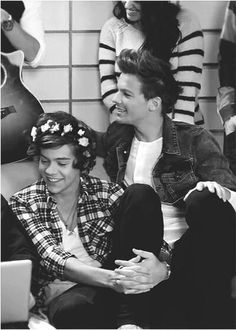 Hary looks so cute with flowers in his hair (; haha