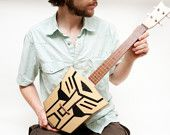 Celentano Woodworks creates amazing, custom made string instruments from wood. They are all incredible but I have to give it up for the Autobot Ukelele.