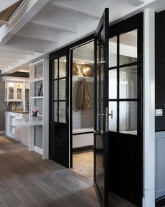 mud room + black doors to enter into the house - nice to close it off from the cold and still get light AND a view! Home, House Design, French Doors Interior, New Homes, Black Interior Doors, Black Doors, House Interior, Painting Interior Doors Black, Mudroom