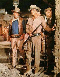 "John Wayne, Robert Mitchum in ""El Dorado"" (1966). Director: Howard Hawks."