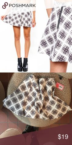 """Motel Zeca Skater Skirt Going grunge and lovin' it! The Zeca Skater skirt features a high rise, A-line fit, plaid print and zipper back closure. Best buddied up with a crop top, choker, and a pair of chunky boots!  15"""" length no stretch, unlined 100% cotton hand wash cold, dry flat imported Motel Rocks Skirts Circle & Skater"""