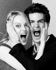 Emma stone and Andrew Garfield. They are  ADORABLE together. I mean.... LOOK AT THEM!