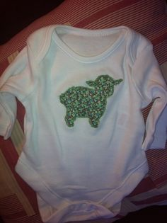 Applique liberty lamb on baby grow... First machine applique attempt using liberty tana lawn in pepper turquoise