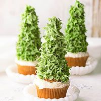 O Tannenbaum Cupcakes - 2 - 16 oz. cans creamy white frosting or vanilla frosting - powdered sugar - cupcakes - rolled sugar ice cream cones - green and brown paste food colorings - white and/or green edible glitter or sprinkles - small pearl candies -