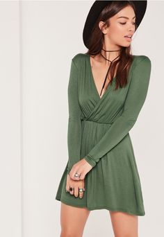 Get wrapped up in simple day dresses to bring your style to life - featuring a sage green hue and a chic skater style.