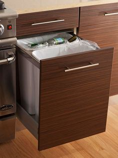 Don't let garbage cans take away from the feel of your kitchen! Keep trash and recycling bins tucked away with storage-savvy drawers. More kitchen storage ideas: http://www.bhg.com/kitchen/storage/organization/new-kitchen-storage-ideas/?socsrc=bhgpin061813trachbin=22