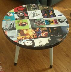 Repurposed coffee table with album covers on top.