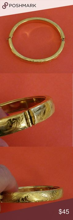 Vintage Gold Repousse Engraved Bangle Very elegant hinged bangle bracelet with antique repousse floral engraving in rich gleaming Gold tone.  It is near mint condition. The yellow gold tone shines and there is no dents or damage. Not marked for content it is probably gold fill. Jewelry Bracelets