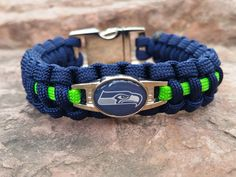 Officially Licensed Seattle Seahawks survival paracord bracelet.  Handmade By US Veterans  http://handmadebyheroes.com/products/handmade-nfl-seattle-seahawks-paracord-bracelet